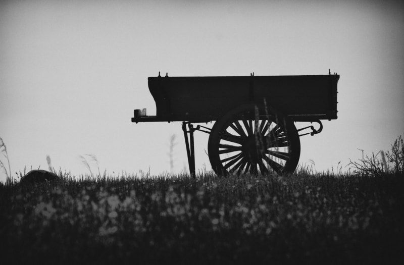 semi-silhouette of a cart on a hillside