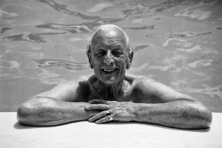 elderly man in swimming pool, smiling