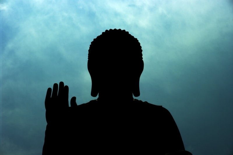 silhouette of a buddha head